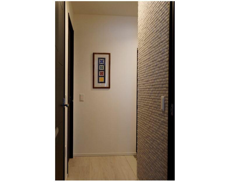 玄関から遮られた廊下はプライベート感を重視。 イメージ